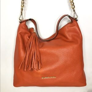 Michael Kors Burnt Orange Tassel Zip Top Hobo Bag
